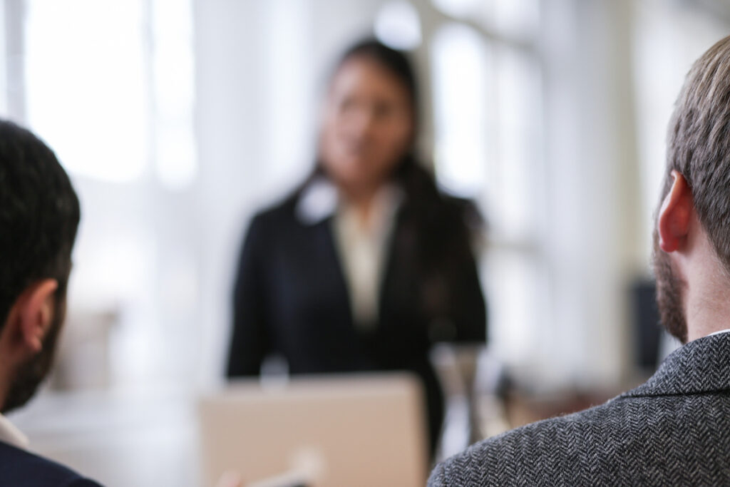 job seeker answering common interview questions asked by two hiring staff