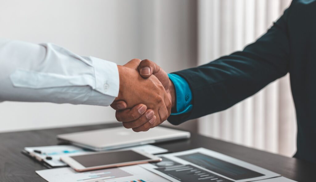 recruiter and job applicant shaking hands after successful job interview